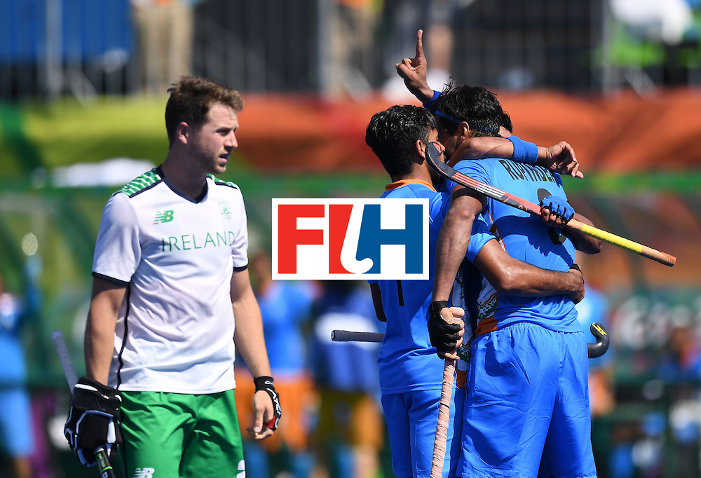 India's Rupinder Pal Singh (R) celebrates scoring a goal with teammates during the men's field hockey India vs Ireland match of the Rio 2016 Olympics Games at the Olympic Hockey Centre in Rio de Janeiro on August, 6 2016. / AFP / MANAN VATSYAYANA        (Photo credit should read MANAN VATSYAYANA/AFP/Getty Images)