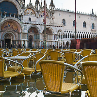 Tables and chairs in one of the cafe in St Mark Square in  central Venice during seasonal High Tide. A few days of exceptional high tides up to 120cm are expected during the next few days..