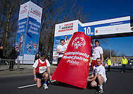 (L) Trainer Henryk Ostrykiewicz & (2L) trainer Ernest Krajewski and (2R) athlete Grzegorz Lewandowski and (R) athlete Marian Gargula of Special Olympics attend a Warsaw Orlen Marathon on April 21, 2013..The mission of Special Olympics is to provide sports training and athletic competition for children and adults with intellectual disabilities...Poland, Warsaw, April 21, 2013..Picture also available in RAW (NEF) or TIFF format on special request...For editorial use only. Any commercial or promotional use requires permission...Photo by © Adam Nurkiewicz / Mediasport