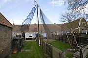 Fishing nets in gardens of houses, Zuiderzee museum, Enkhuizen, Netherlands