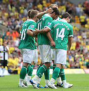 Andrew Surman of Norwich City scores his sides 2nd goal and celebrates with Grant Holt and his team mates during a pre season friendly at Carrow Road Stadium, Norwich...Picture by Paul Chesterton/Focus Images Ltd.  07904 640267.6/8/11