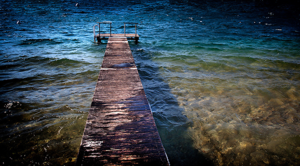 A private dock (ponton prive) on Lake Annecy in France.