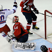 28 April 2009:   New York Rangers right wing Nik Antropov (80) raises his arm after scoring a goal against Washington Capitals goalie Simeon Varlamov (40) in the 1st period in the seventh game of the Eastern Conference NHL quarterfinal playoff game at the Verizon Center in Washington, D.C.  The Washington Capitals defeated the New York Rangers 2-1 in the Eastern Conference NHL quaterfinal playoff to advance to the second round of the playoffs.