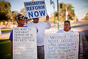 July 6 - PHOENIX, AZ: RUNNINGDEER (one name, left) and other immigrants' supporters, picket the Arizona state capitol in Phoenix Tuesday evening.  Immigrant rights' activists have been holding a prayer vigil in opposition to Arizona's tough new anti-illegal immigrant law, SB 1070, which is supposed to take effect on July 29. The bill requires local police and law enforcement agencies to verify the immigration status of people they suspect might be in the US illegally. Opponents of the bill fear it will lead to racial profiling. The US Justice Department announced Tuesday afternoon that they would file suit against Arizona to prevent implementation of SB 1070. They are filing suit on the grounds that immigration enforcement is the exclusive domain of the federal government.       Photo by Jack Kurtz