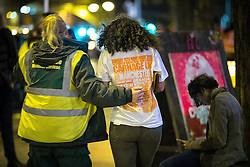 """© Licensed to London News Pictures . 15/11/2015 . Manchester , UK . A medic tends to a reveller . Annual student pub crawl """" Carnage """" at Manchester's Deansgate Locks nightclubs venue . The event sees students visit several clubs over the course of an evening . This year's theme is """" Animal Instinct - unleash your beast """" . Photo credit : Joel Goodman/LNP"""
