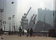 """Ground Zero New York City day 3 after the attcak on the Wolrd Trade Center. For Reuters New Agency. Through my eyes and with my camera I am able to see the world we live in, and try to bring things into focus. Photography preserves my vision of what """"I see"""" at a specific time and place- a moment. Creating a bond between  me and my subject and capturing and emotion for eternity. Having lived and worked in New York City for over 15 years when 911 happened. I had to go and """"see"""" with my camera what lower Manhattan was like after this horrific attack on our Nation. The World Trade Center owned the skyline in lower Manhattan making it feel more like a canyon. After the Twin Towers fell, and I saw with my own eyes and camera the destruction, I realized what little land they actually sat on. The Twin Towers may not have occupied a large plot of land but they now touched everyones life. Photo©SuziAltman"""