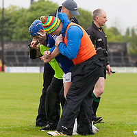 Cratloe's Padraic Collins receives treatment during the Senior Hurling Championship with Ballyea