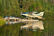 Float plane and boat on Lac Seul<br /> Ear Falls<br /> Ontario<br /> Canada