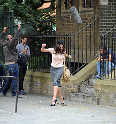 Model Kelly Brook and Junichi Kajioka filming scenes of a new movie called Taking Stock. London, UK. 02/07/2013<br />BYLINE MUST READ : GOTCHAIMAGES.COM<br /><br />Copyright by © Gotcha Images Ltd. All rights reserved.<br />Usage of this image is conditional upon the acceptance <br />of Gotcha Images Ltd, terms and conditions available at<br />www.gotchaimages.com