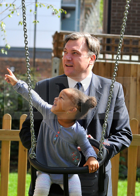 SOUTH BERMONDSEY, LONDON:  Ed Balls pushes EdenTingling on a swing.  Ed Balls, Labour Leadership candidate joins shadow housing minister John Healey and  shadow work and pensions secretary Yvette Cooper  during a visit to a housing development, The Falcon Works development, in central London on 31 August 2010. STEPHEN SIMPSON..