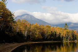 Clouds drape the summit of Mount Katahdin Lake as seen from Maine's Katahdin Lake.  Near Baxter State Park.