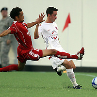 Richmond Kickers Midfielder David Bulow (10) defends against Orlando City Lions Defenseman Jack Traynor (6) during a United Soccer League Pro soccer match between the Richmond Kickers and the Orlando City Lions at the Florida Citrus Bowl on May 25, 2011 in Orlando, Florida.  (AP Photo/Alex Menendez)