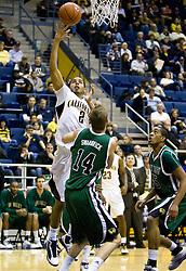 December 28, 2009; Berkeley, CA, USA;  California Golden Bears guard Jorge Gutierrez (2) shoots over Utah Valley Wolverines guard Jordan Swarbrick (14) during the first half at the Haas Pavilion.  California defeated Utah Valley 85-51.