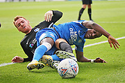 Peterborough United midfielder Siriki Dembele (10) and Portsmouth midfielder Tom Naylor (7) during the EFL Sky Bet League 1 match between Peterborough United and Portsmouth at London Road, Peterborough, England on 15 September 2018.