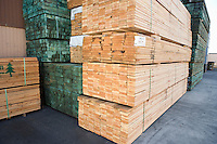 Stacks of wood outside warehouse