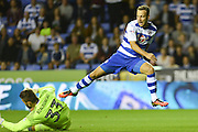 Reading FC striker (7) Roy Beerens hurdles Ipswich Town goalkeeper Bartosz Bialkowski (33) during the EFL Sky Bet Championship match between Reading and Ipswich Town at the Madejski Stadium, Reading, England on 9 September 2016. Photo by Mark Davies.