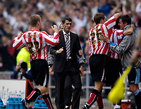 Photo: Jed Wee.<br />Sunderland v Leicester City. Coca Cola Championship. 16/09/2006.<br /><br />Sunderland players rush in to celebrate with assistant manager Tony Loughlan (R) as manager Roy Keane looks a detached figure.