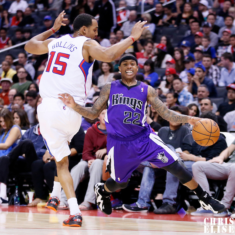25 October 2013: Sacramento Kings point guard Isaiah Thomas (22) drives past Los Angeles Clippers center Ryan Hollins (15) during the Sacramento Kings 110-100 victory over the Los Angeles Clippers at the Staples Center, Los Angeles, California, USA.