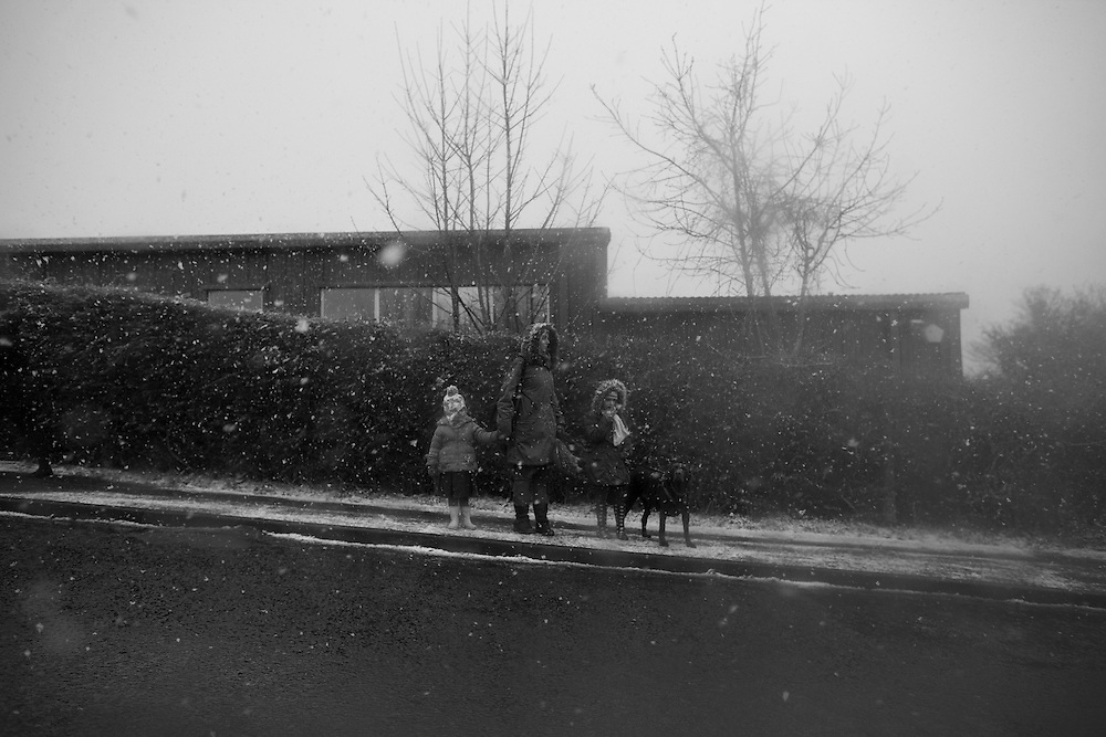 A mother walks her children to school during a snowstorm in Berkhamsted Thursday, Jan. 29, 2015 (Elizabeth Dalziel) #thesecretlifeofmothers #bringinguptheboys #dailylife
