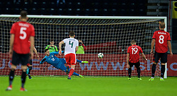 ELBASAN, ALBANIA - Tuesday, November 20, 2018: Wales' goalkeeper Daniel Ward is beaten as Albania's Bekim Balaj scores the first goal from a penalty kick during the International Friendly match between Albania and Wales at the Elbasan Arena. (Pic by David Rawcliffe/Propaganda)