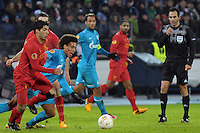 Thu., Feb. 14, 2013, Russia, St. Petersburg. .Liverpool's Luis Suarez, left, against  Zenit St. Petersburg's Axel Witsel, 2nd left, in the UEFA Europa League's last 32 match..Kommersant Photo/Alexander Petrosyan