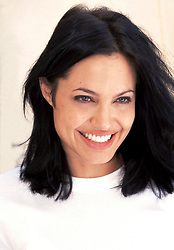 June 2000 - Hollywood, California, U.S. - Newlywed ANGELINA JOLIE, 24, in white t-shirt, fresh from her honeymoon with B.B. Thornton (married May 5, 2000). Jolie, just won Best Actress in a Supporting Role 2000 Oscar for her performance in Girl, Interrupted. Based on a real woman from Susanna Kaysen's memoir, Lisa Rowe is perhaps the most striking character in the film. Young, beautiful and oozing with seductive charisma, Lisa is a sociopath and a patient at Claymore hospital where she has resided for the past 7 years. Proud of her diagnoses, mocks her doctors and refuses to take her medication. (Credit Image: © Armando Gallo via ZUMA Studio)