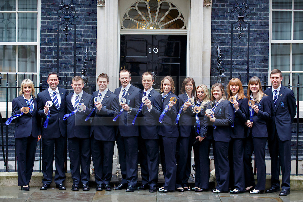 © licensed to London News Pictures. London, UK 25/02/2014. Winter Olympic medal winners of Team GB posing with their medals whilst visiting Downing Street to meet Prime minister David Cameron on Tuesday, 25 February 2014 after their success in the Sochi 2014 Winter Olympics. Photo credit: Tolga Akmen/LNP