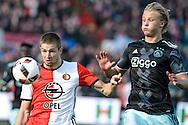 23-10-2016: Voetbal: Feyenoord v Ajax: Rotterdam<br /> <br /> (L-R) Feyenoord speler Jan-Arie van der Heijden, Ajax speler Kasper Dolberg tijdens het Eredivsie duel tussen Feyenoord en Ajax op 23 oktober in stadion Feijenoord (de Kuip) tijdens speelronde 10<br /> <br /> Eredivisie - Seizoen 2016 / 2017<br /> <br /> Foto: Gertjan Kooij