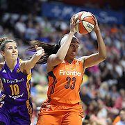 UNCASVILLE, CONNECTICUT- JULY 15:  Morgan Tuck #33 of the Connecticut Sun rebounds while challenged by Evgeniia Belyakova #10 of the Los Angeles Sparks during the Los Angeles Sparks Vs Connecticut Sun, WNBA regular season game at Mohegan Sun Arena on July 15, 2016 in Uncasville, Connecticut. (Photo by Tim Clayton/Corbis via Getty Images)