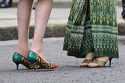 © Licensed to London News Pictures. 13/09/2016. London, UK. Detail showing the shoes worn as British prime minister THERESA MAY (left) greets Myanmarese politician AANG SAN SUU KYI (right) on the steps of 10 Downing Street ahead of a meeting between the two leaders.  Photo credit: Ben Cawthra/LNP