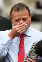 © Licensed to London News Pictures. 12/06/2018. London, UK.  Leave.EU founder ARRON BANKS arrives at Portcullis House in London where he is due to give evidence to a Commons Digital, Culture, Media and Sport Committee about fake news. Arron Banks and his Leave.EU colleague Andy Wigmore have been accused of collusion with Russian officials around the time of the Brexit referendum. Photo credit: Ben Cawthra/LNP