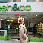 """May 3, 2012 - Manhattan, NY : Musician and composer Michael Arenella passes a """"fresh & co"""" on 57th Street in midtown on his way to Worth & Worth, a men's and women's hat store located at 45 West 57th St. in Manhattan, on Thursday. CREDIT : Karsten Moran for The New York Times"""