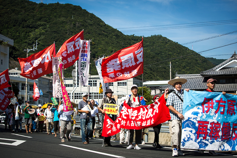 EHIME, JAPAN - AUGUST 11 : Anti-nuclear protesters chant while walking with their banners and signs around Ikata town to protest against the restarting of a nuclear reactor on August 11, 2016 in Ikata, Ehime prefecture, northwestern Shikoku, Japan. The No. 3 reactor of the nuclear plant is expected to resume operations this week after The Nuclear Regulation Authority (NRA's) has completed it's final inspections of the plant's operational safety measures. The plant has not generated nuclear power since Japan's 2011 nationwide shutdown of all nuclear plants in the aftermath of the Fukushima Daiichi nuclear disaster. Ikata Nuclear Power Plant will be the third nuclear power plant in Japan to become operational. (Photo by Richard Atrero de Guzman/NURPhoto)