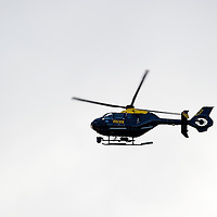 Perth Manhunt.....24.10.12<br /> A police helicopter pictured over Kinnoull Hill in Perth today joining a manhunt for prisoner Lee Cyrus who has absconded from North Sea Camp, Boston, Lincs..Police decended on the area around Kinnoull Hill sealing it off after a possible sighting of Lee Cyrus was reported, using a rmed police and dogs to search the wooded Perthshire beauty spot.<br /> Picture by Graeme Hart.<br /> Copyright Perthshire Picture Agency<br /> Tel: 01738 623350  Mobile: 07990 594431
