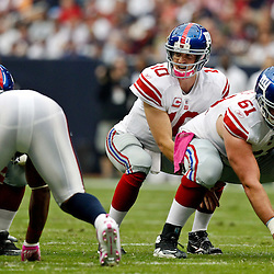 October 10, 2010; Houston, TX USA; New York Giants quarterback Eli Manning (10) under center during the first half of a game against the Houston Texans at Reliant Stadium. Mandatory Credit: Derick E. Hingle