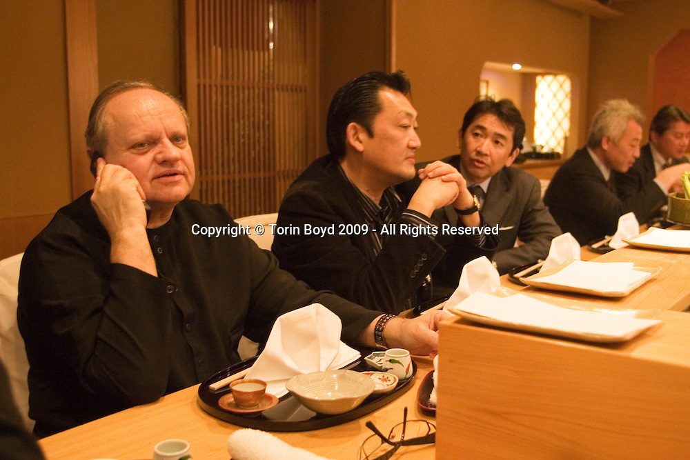"This is world renowned chef Joel Robuchon shortly after arriving Tokyo on February 6, 2009. Here is seen here having dinner at a high end Japanese tempura restaurant called Tempura Tensei which is listed with one star in the Japanese Michelin Guide. The two Japanese men next to him are Mitsugu Yasuda (1st on his left) who's closely assisting Robuchon during his stay in Japan, and Ken Matsui (2nd on his left), Senior Managing Director of Four Seeds Corporation his is Robuchon's partner company in Japan. Robuchon traveled from his home base in Paris via Air France to attend an international food exposition called ""2009 Tokyo Taste"". This three day event from February 9-11, 2009 showcases some of the world's most famous chefs including Robuchon and Ferran Adria (of El Bulli) who are both Honorary Advisors to this event. Other chefs participating in this event are Heston Blumenthal, Pierre Gagnaire, Jacques Puisais, Bruno Menard, Herve This, Ferran Adria, and Nobuyuki Matsuhisa to name a few. Robuchon also has restaurants in Tokyo and Nagoya Japan including; L'Atelier de Joel Robuchon and the prestigious Le Chateau de Joel Robuchon. These establishments are connected with Four Seeds Corporation, a Japanese corporation that owns and operates several popular restaurant chains around Japan."