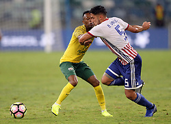 20112018 (Durban)<br /> Paraguay player Bruno Valdez and Bafana player Thulani Serero tackling for a ball during a match were Bafana Bafana and Paraguay have drawn 1-1 in the Nelson Mandela Challenge match played at Moses Mabhida Stadium in Durban on Tuesday evening.<br /> Picture: Motshwari Mofokeng/African News Agency (ANA)