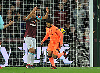Football - 2017 / 2018 Premier League - West Ham United vs. Liverpool<br /> <br /> Mohamed Salah of Liverpool scores goal no 1 as Winston Reid complains at his defence, at The London Stadium.<br /> <br /> COLORSPORT/ANDREW COWIE