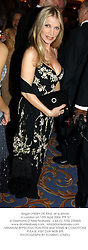 Singer LYNSEY DE PAUL at a dinner in London on 13th April 2004.PTF 57