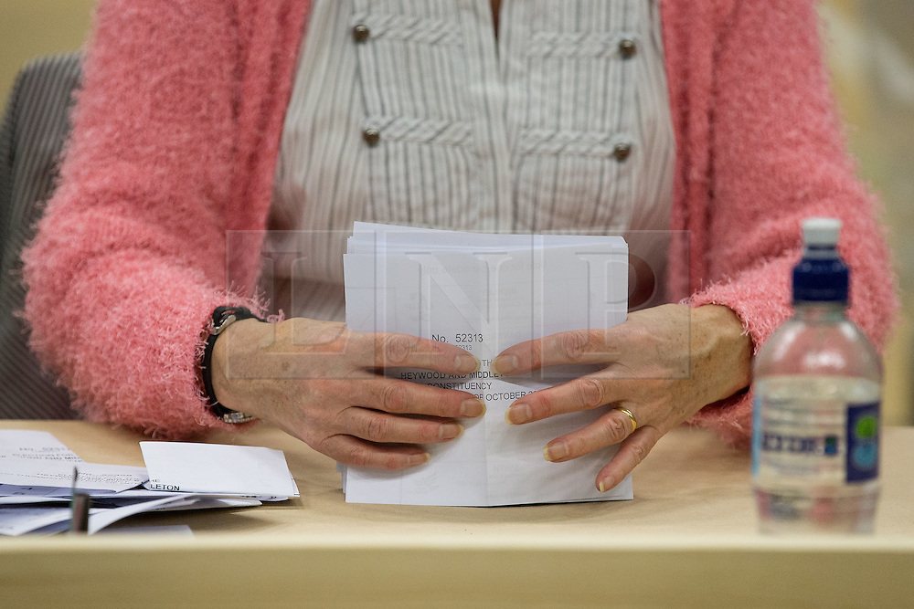 © Licensed to London News Pictures . 09/10/2014 . Heywood , UK . Ballots being counted at the Heywood and Middleton by-election count which is taking place following the death of sitting MP Jim Dobbin . Photo credit : Joel Goodman/LNP