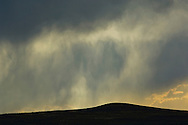 Sunlit rain storm clouds and downpour over the open range, near Farson, Wyoming