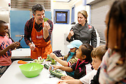 Uber CEO Travis Kalanick (L) works with chef Amy Kien, of Revolution Food, to help with Cooking Matters, a nutrition class taught by 18 Reasons, a local partner of Share our Strength at Glen Park Elementary School in San Francisco, California, December 10, 2014. REUTERS/Beck Diefenbach (UNITED STATES)