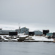 Buildings of the Vernadsky Research Base as seen from the water. Originally established by the British first as Base F in the British Falkland Islands Dependencies and later as Faraday Station, it was transferred to the Ukraine in 1996 and renamed Vernadsky Research Base after Soviet mineralogist Vladimir Vernadsky.