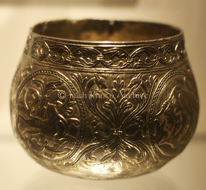 Decorative Viking hoard cups. (Named the Vale of York cup and the Halton Moor Cup) Made from gold and silver. Decorated with animals and foliate patterns. Found buried in England. Were buried shortly after AD 927.