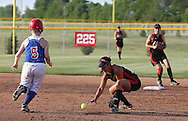 Linn-Mar's Kelsey Duggan (12) tries to grab the ball as Washington's Anne Riley (5) runs to second during the softball game between Cedar Rapids Washington and Linn-Mar at Oak Ridge Middle School in Marion on Thursday, June 20, 2013. The Lions defeated the Warriors 7-6 in 9 innings.