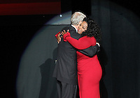 """Ball State alumnus David Letterman, host of CBS's """"Late Show,"""" hugs media icon and philanthropist Oprah Winfrey before they sit down together at Ball State University in Muncie, Indiana November 26, 2012.  The conversation is part of the  David Letterman Distinguished Professional Lecture and Workshop Series, established in 2008."""