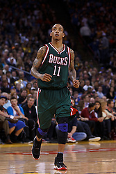 Mar 16, 2012; Oakland, CA, USA; Milwaukee Bucks point guard Monta Ellis (11) during a stoppage in play against the Golden State Warriors during the fourth quarter at Oracle Arena. Milwaukee defeated Golden State 120-98. Mandatory Credit: Jason O. Watson-US PRESSWIRE