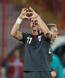 NOVI SAD, SERBIA - Tuesday, September 11, 2012: Wales' Gareth Bale celebrates scoring the first goal against Serbia during the 2014 FIFA World Cup Brazil Qualifying Group A match at the Karadorde Stadium. (Pic by David Rawcliffe/Propaganda)