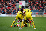 Burton Albion defender John Brayford (3) watches on as Burton Albion defender Kyle McFadzean (5) and Burton Albion striker Marvin Sordell (9) and Bristol City midfielder Korey Smith (7) fight for the ball during the EFL Sky Bet Championship match between Bristol City and Burton Albion at Ashton Gate, Bristol, England on 4 March 2017. Photo by Richard Holmes.