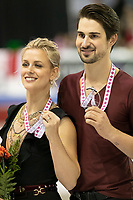 KELOWNA, BC - OCTOBER 26: Ice dance silver medalists, Madison Hubbell and Zachary Donohue of the United States, stand on the ice during medal ceremonies of Skate Canada International held at Prospera Place on October 26, 2019 in Kelowna, Canada. (Photo by Marissa Baecker/Shoot the Breeze)